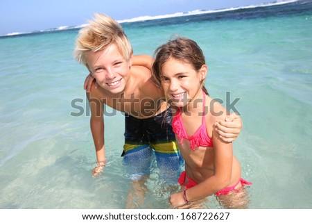 Kids having fun at the beach - stock photo