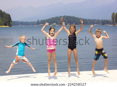 Kids having fun on their summer vacation - stock photo