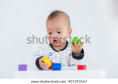 Kids inspecting their wooden block buildings - stock photo
