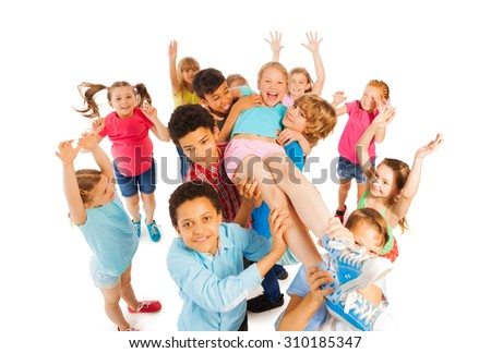 Kids lifting popular classmate and cheering - stock photo