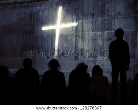 Kids looking at a cross on a wall collage. - stock photo
