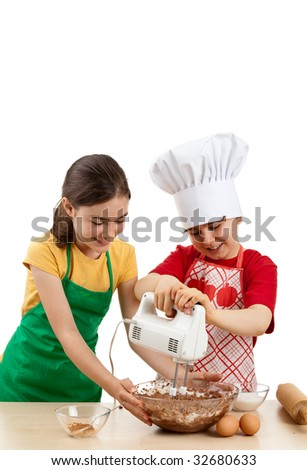 Kids mixing dough isolated on white background - stock photo