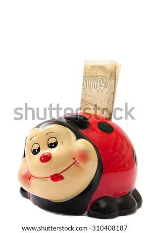 Kids money box for savig money on the white background. - stock photo