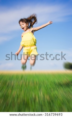 kids on field running blurred. - stock photo