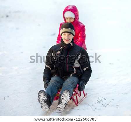 Kids  on sleigh - stock photo