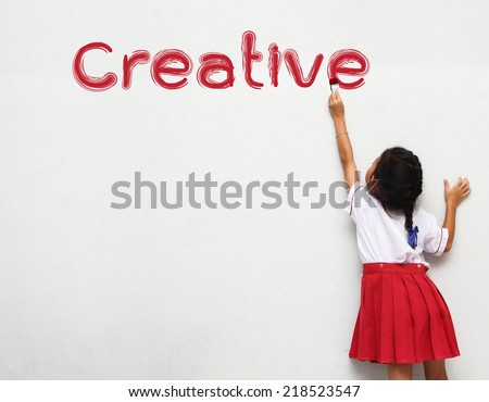 kids painting creative word on wall - stock photo