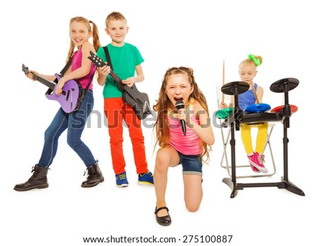 Kids play musical instruments and girl sings - stock photo