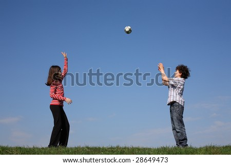 Kids playing ball outdoor - stock photo