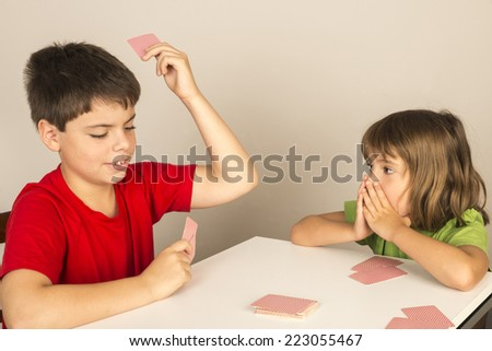 kids playing cards at home  - stock photo