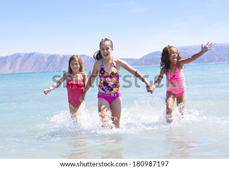 Kids Playing together at the beach - stock photo