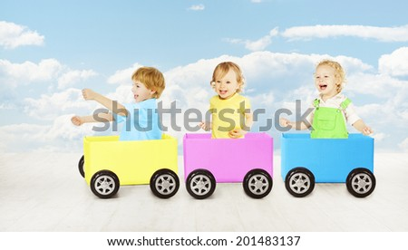 Kids playing toy car. Children passenger sitting in box. Inspiration and creativity cargo concept - stock photo