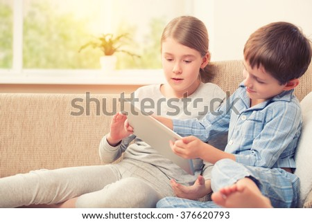 Kids playing with digital tablet - stock photo
