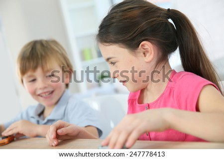 Kids playing with toy cars at home - stock photo