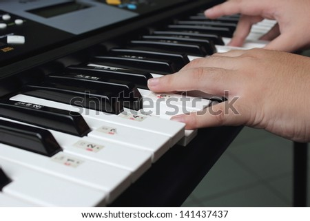Kids practicing keyboard player. - stock photo