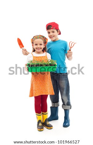 Kids prepared to plant the seedlings - growing food, isolated - stock photo