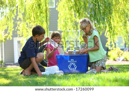 Kids recycling outdoors - stock photo