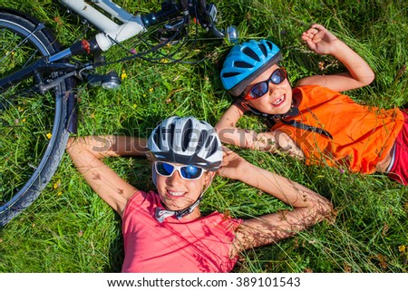 Kids resting after biking - stock photo