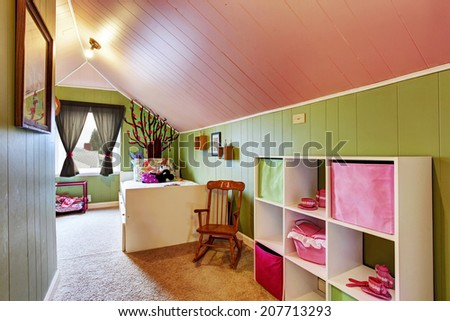 Kids room with vaulted ceiling in contrast green and pink colors - stock photo