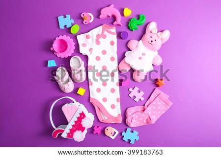 Kids setting on purple background - stock photo