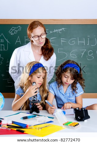 kids students with nerd teacher woman at science classroom - stock photo