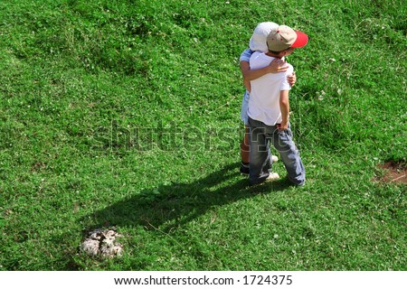 Kids together. Girl and boy, best friends watching sunset. Children friends concept - stock photo
