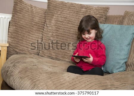 Kids TV on a tablet - stock photo