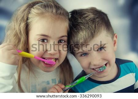 Kids washing teeth. - stock photo