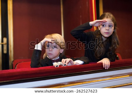 kids watching a theater play - stock photo