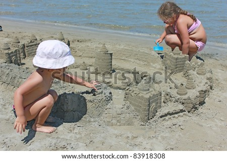 kids with sand castle - stock photo