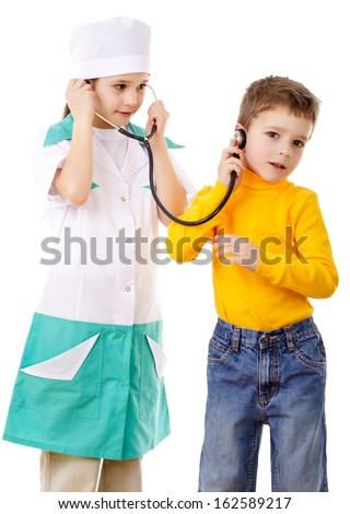 Kids with stethoscope playing in a doctor, isolated on white - stock photo