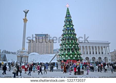 KIEV - DEC 22: Christmas Tree and Independence monument in Kiev, Ukraine on December 22, 2012. Santa Clasus Parade starts on Dec 22 on Kreshatik street. - stock photo