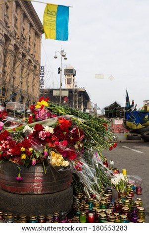 KIEV (KYIV), UKRAINE - MARCH 7, 2014: Ukrainian revolution, Euromaidan. Days of national mourning for killed defenders of #Euromaidan. Flowers and lighted lamps on barricades defenders of #Euromaidan - stock photo