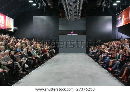 KIEV - OCTOBER 16: Guests wait for fashion models parade at men's designer Nataliya Soboleva fashion show during Ukrainian Fashion week October 16, 2006 in Kiev, Ukraine. - stock photo