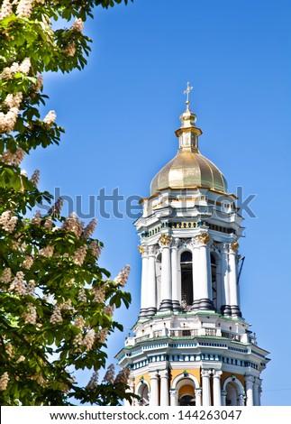 Kiev Pechersk Lavra monastery in Kiev and chesnut blossom - stock photo