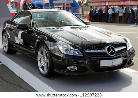 "KIEV - SEPTEMBER 7: Black Mercedes-Benz SL-class at yearly automotive-show ""Capital auto show 2012"". September 7, 2012 in Kiev, Ukraine - stock photo"