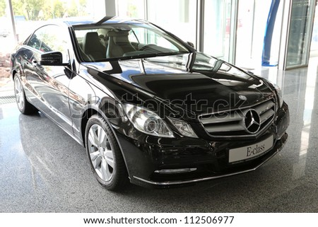 "KIEV - SEPTEMBER 7: Mercedes-Benz E-class (E 250) at yearly automotive-show ""Capital auto show 2012"". September 7, 2012 in Kiev, Ukraine - stock photo"