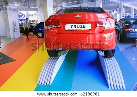 "KIEV - SEPTEMBER 10: Red Chevrolet Cruze at Yearly automotive-show ""Capital auto show 2010"". September 10, 2010 in Kiev, Ukraine. - stock photo"