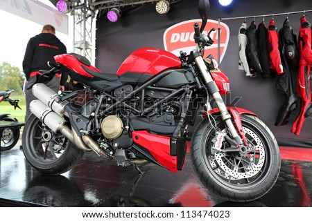 """KIEV - SEPTEMBER 7: Red Ducati motorcycle at yearly automotive-show """"Capital auto show 2012"""". September 7, 2012 in Kiev, Ukraine - stock photo"""