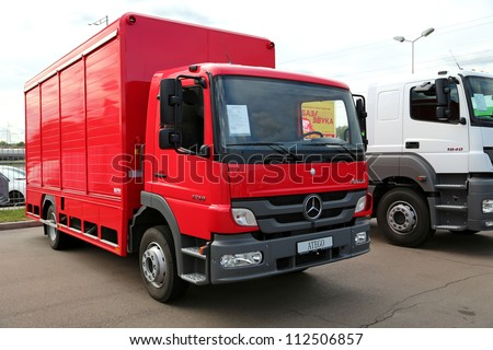 """KIEV - SEPTEMBER 7: Red Mercedes-Benz Atego at yearly automotive-show """"Capital auto show 2012"""". September 7, 2012 in Kiev, Ukraine - stock photo"""