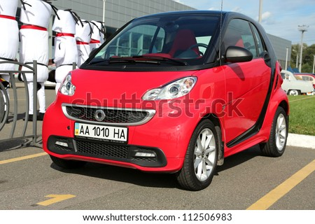 "KIEV - SEPTEMBER 7: Red Smart at yearly automotive-show ""Capital auto show 2012"". September 7, 2012 in Kiev, Ukraine - stock photo"
