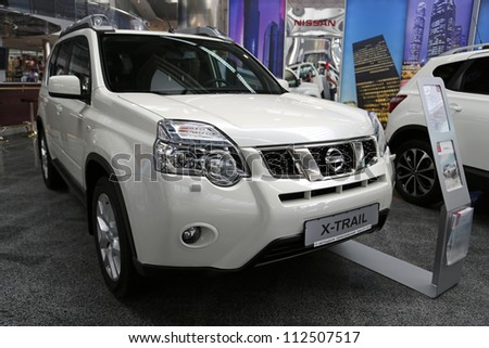 "KIEV - SEPTEMBER 7: White Nissan X-Trail at yearly automotive-show ""Capital auto show 2012"". September 7, 2012 in Kiev, Ukraine - stock photo"