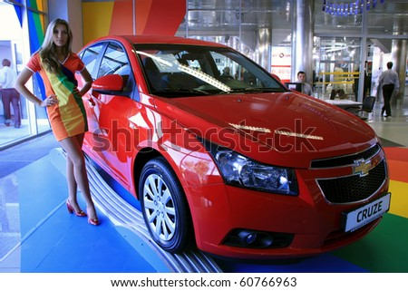 "KIEV - SEPTEMBER 10: Yearly automotive-show ""Capital auto show 2010"". September 10, 2010 in Kiev, Ukraine. Red Chevrolet Cruze - stock photo"