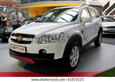 "KIEV - SEPTEMBER 10: Yearly automotive-show ""Capital auto show 2010"". September 10, 2010 in Kiev, Ukraine. White Chevrolet Captiva - stock photo"