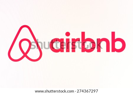 KIEV, UKRAINE - APRIL 23, 2015: Airbnb logo sign on pc sign. Airbnb an online platform for accommodation, search and short-term private rental accommodation worldwide. - stock photo