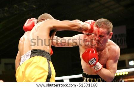 KIEV, UKRAINE - APRIL 19: WBA welterweight belt holder Yuriy Nuzhnenko (R) throws a punch against Irving Garcia during their WBA World Welterweight Title fight on April 19, 2008 in Kyiv, Ukraine - stock photo