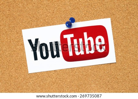 KIEV, UKRAINE - APRIL 15, 2015: YouTube logotype printed on paper and pinned on cork bulletin board. YouTube is a video-sharing website - stock photo