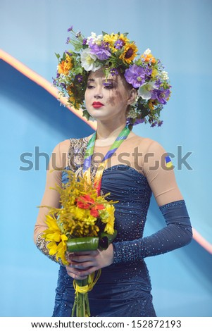 KIEV, UKRAINE - AUGUST 29: Alina Maksymenko of Ukraine win bronze during the 32nd Rhythmic Gymnastics World Championships in Kiev, Ukraine on August 29, 2013 - stock photo