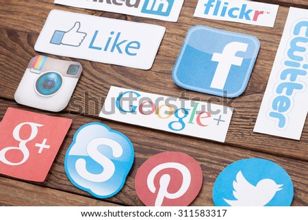 KIEV, UKRAINE - AUGUST 22, 2015:Collection of popular social media logos printed on paper:Facebook, Twitter, Google Plus, Instagram, Skype, Flickr, Pinterest, YouTub on wooden background - stock photo