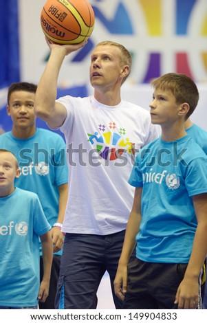 KIEV, UKRAINE - AUGUST 8: Famed Ukrainian basketball player Dmitry Baselevskyi hold a workshop for orphans during the U16 Eurobasket  2013 at Palace of Sport in Kiev, Ukraine on August 8, 2013 - stock photo