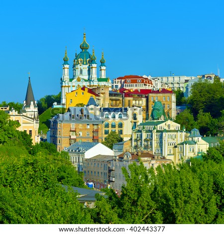 Kiev, Ukraine. Beautiful view of the St. Andrew's Church on the Andrew's Descent among green trees of the Castle Hill in Kyiv - stock photo